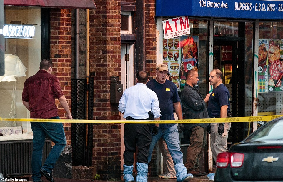 FBI detectives were searching through an Elizabeth, New Jersey apartment (above First American Fried Chicken) Monday morning
