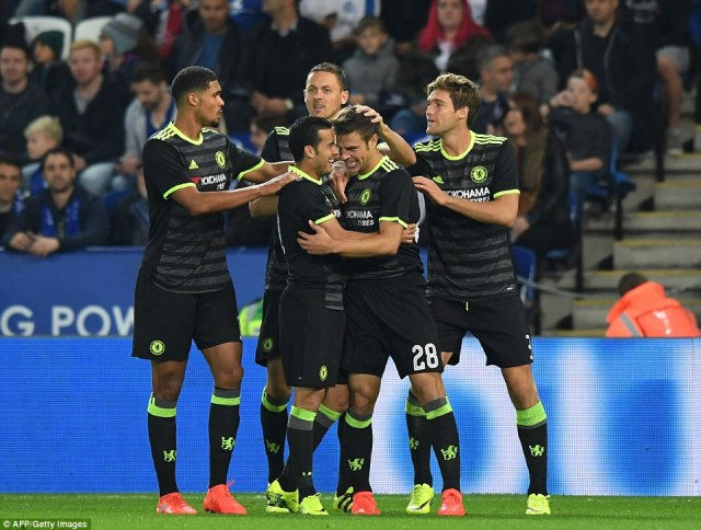 The Chelsea players celebrateAzpilicueta's goal after the Spaniard dragged them back into the cup tie at Leicester