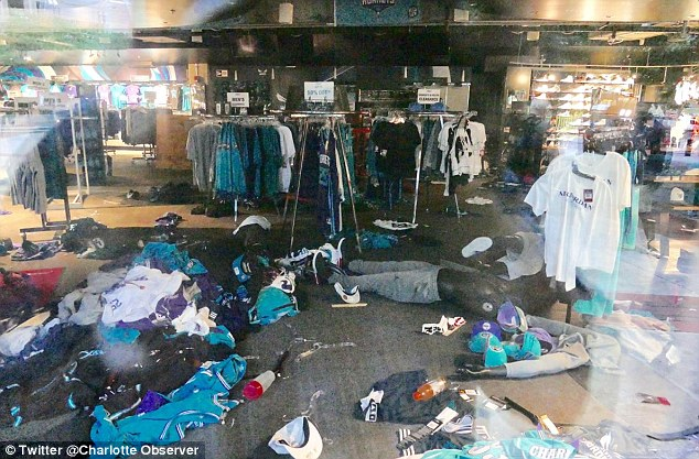 AFTERMATH: A Charlotte Hornets team store was damaged in Wednesday nights clash, which included looting and numerous arrests