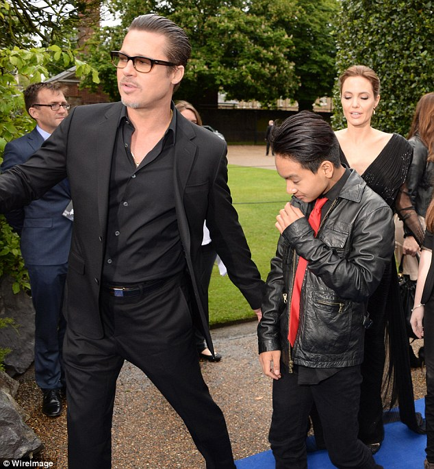 Cause: Brad Pitt's argument with son Maddox led to Angelina Jolie's decision to file for divorce (above in May 2014)