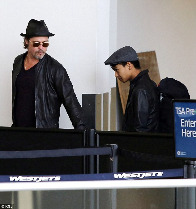 Maddox and Pitt are seen at LAX Airport on June 6, 2015. On Thursday morning, a police car was seen arriving at the Jolie-Pitt compound in the Hollywood Hills