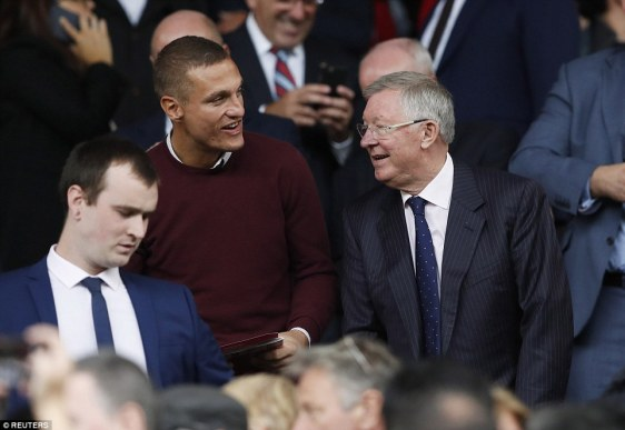 Legendary former Manchester United manager Sir Alex Ferguson watches the match with ex-United defender Nemanja Vidic