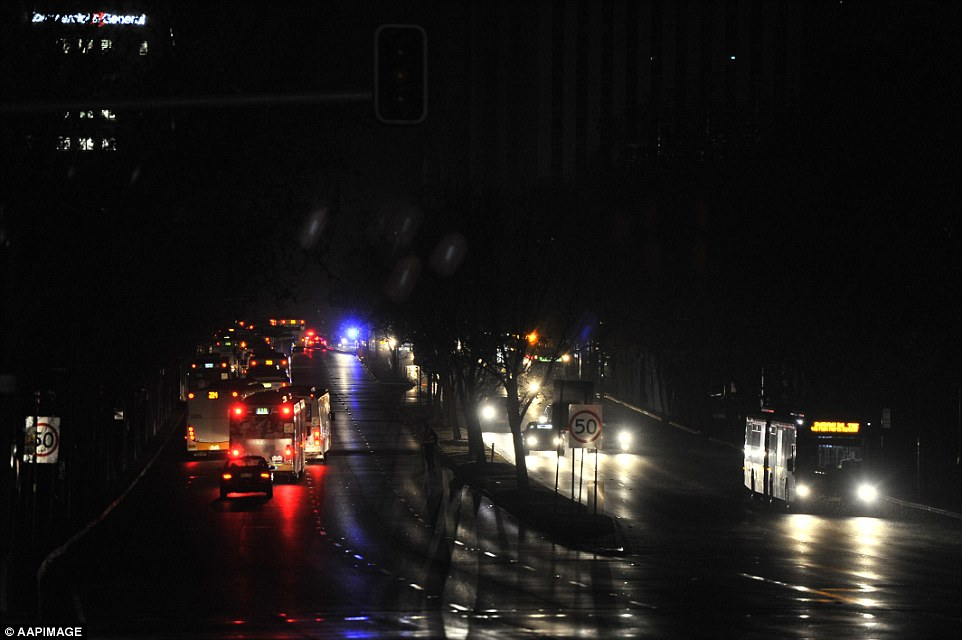 Traffic in total darkness around the streets of Adelaide as residents are left without power on Wednesday night