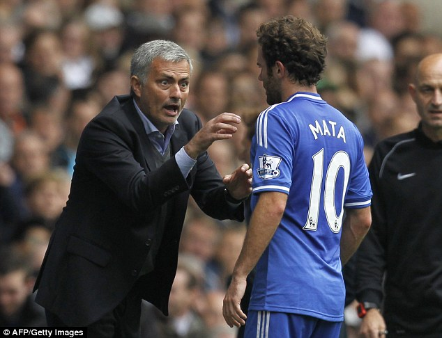 Mata receives instructions from Mourinho during Chelsea's clash with Tottenham in 2013