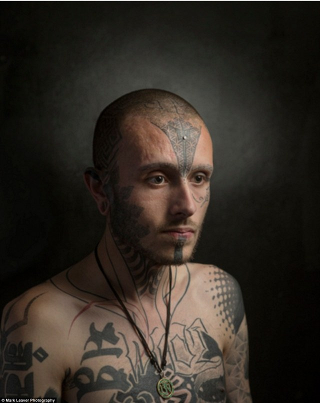 Jack Denny had his eyebrows tattooed on at the age of 18. Mark photographed Jack sitting alongside his family