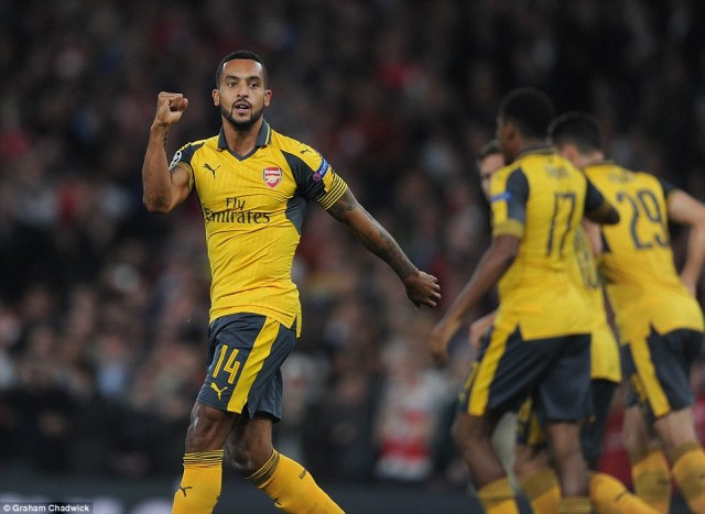 The in-form Gunners forward celebrates after his seventh minute strike seals a strong start for the home side in London
