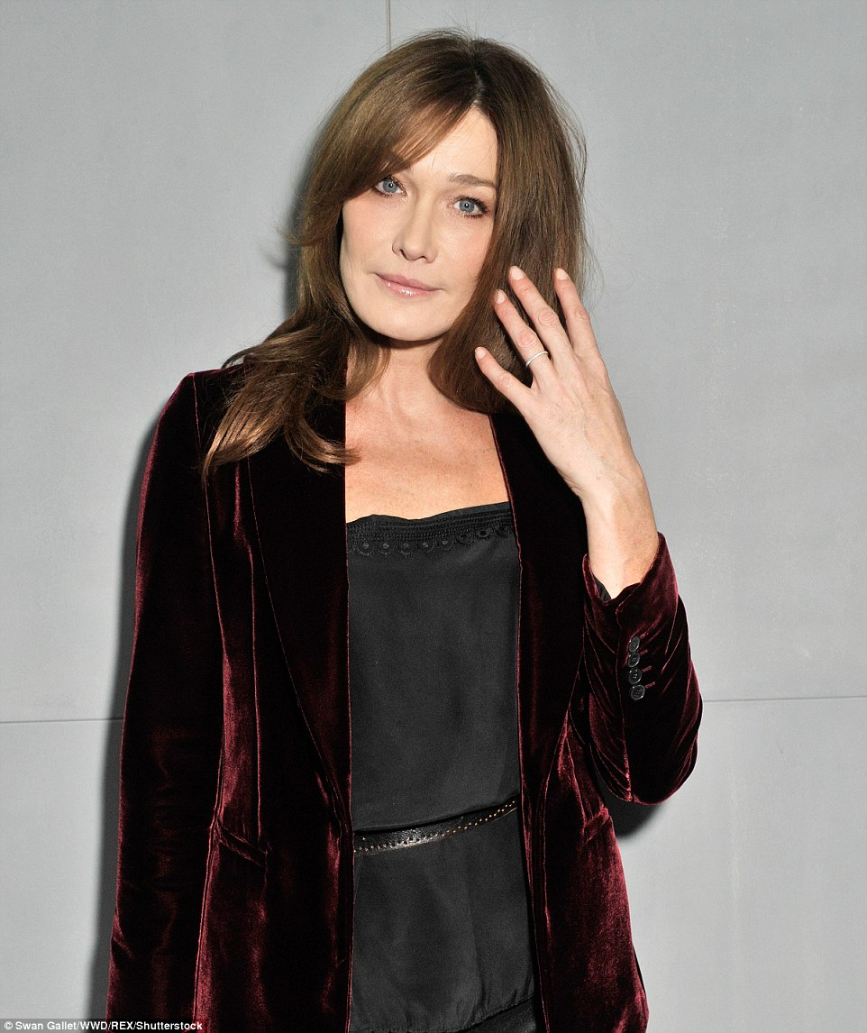 Stunning: The brunette beauty opted for a gorgeous velvet coat as she took her place on the front row