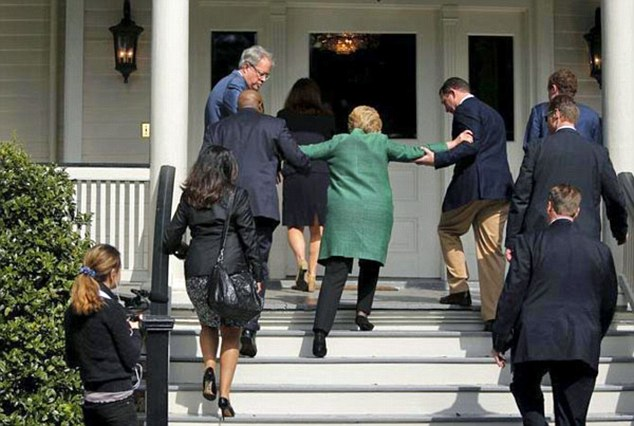 Clinton's health has been questioned after websites circulated an old picture of Hillary Clinton slipping while walking up a flight of stairs (pictured)