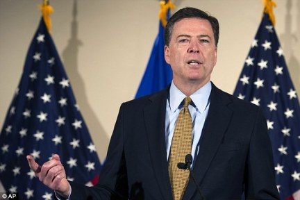 Moment of truth: FBI director James Comey as he announced in July whether Hillary Clinton would be charged. He had been handed authority to decide on prosecution after Loretta Lynch's meeting with Bill was revealed