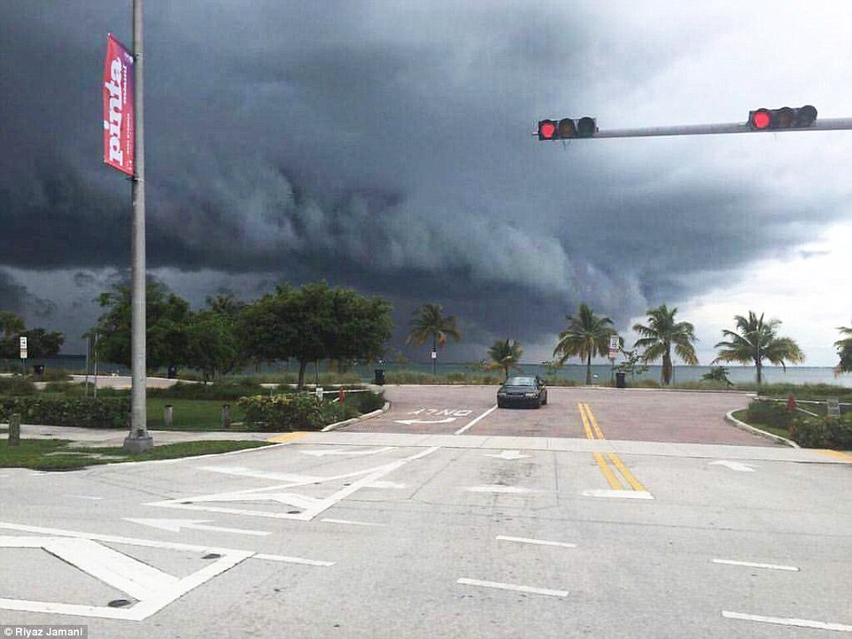 Ominous dark clouds signal the approaching hurricane headed towards Miami in Florida on Thursday