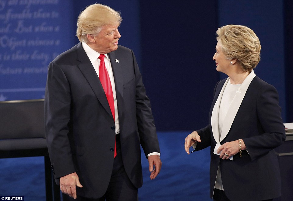 Republican presidential nominee Donald Trump and Democratic candidate Hillary Clinton speak to each other at the end of Sunday's debate