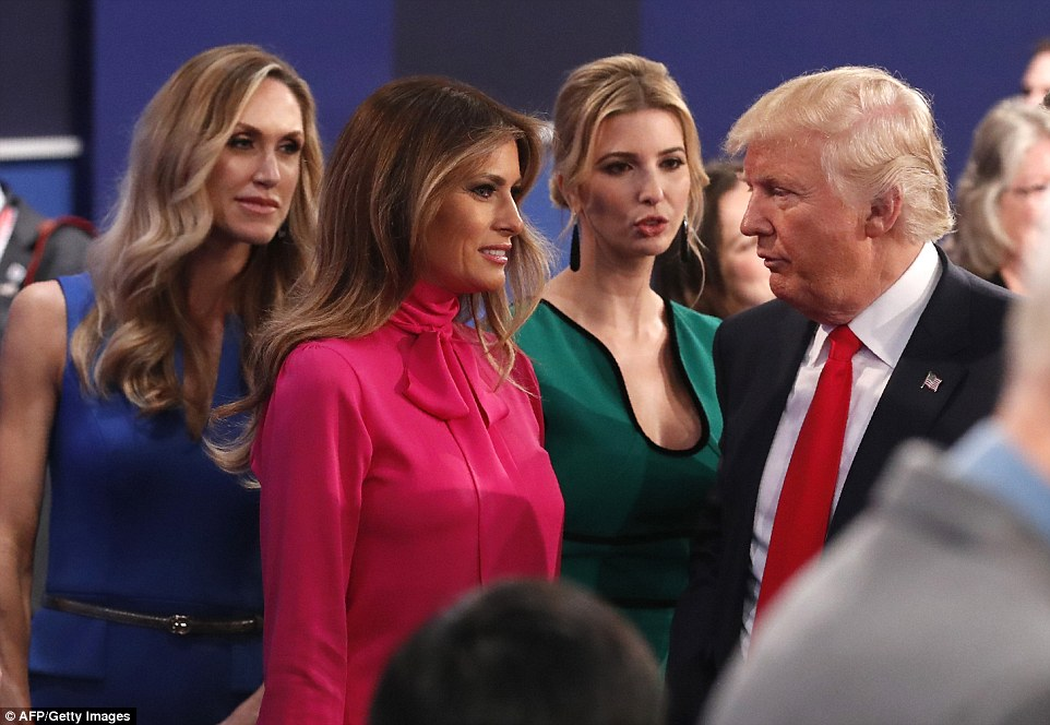 Republican nominee Donald Trump (right) discusses with is daughter Ivanka Trump (second right) his wife Melania Trump (second left) and his daugher in law Lara Yunaska (left)