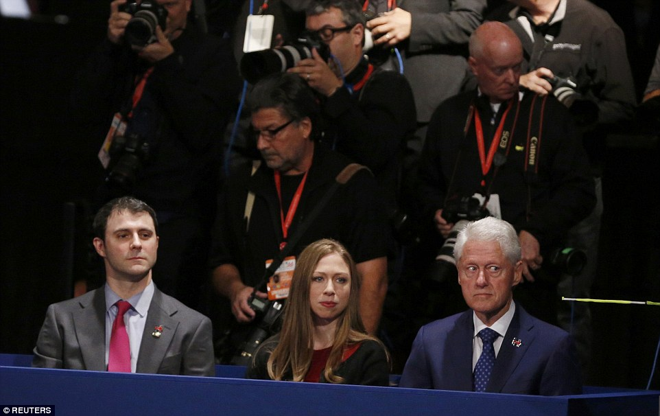 The eyes have it: At times Bill Clinton's face suggested he was not happy with his own alleged crimes and misdemeanors being raised in the debate. He was in the family box with daughter Chelsea and her husband Marc Mezvinsky
