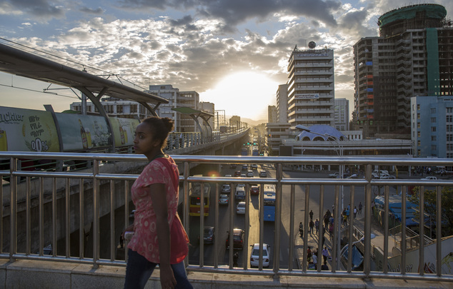 A woman walks on bridge to a station of the city's light railway, in Addis Ababa, Ethiopia Monday, Oct. 10, 2016. Ethiopia's government on Monday blamed Egyp...