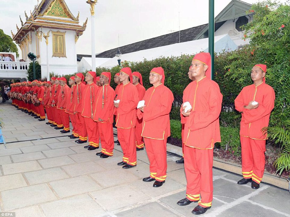 Thai royal officials in ancient costume prepare for the royal bathing ceremony. Bhumibol, the world's longest-reigning monarch, passed away at 88 on Thursday after years of ill health