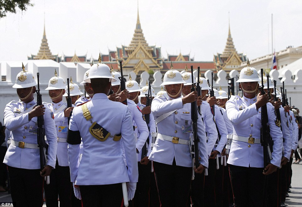 Thai military guards on duty march outside the Grand Palace in Bangkok