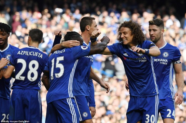 Defender David Luiz (No 30) looks delighted as he enjoys Moses' goal, which was assisted byNathaniel Chalobah