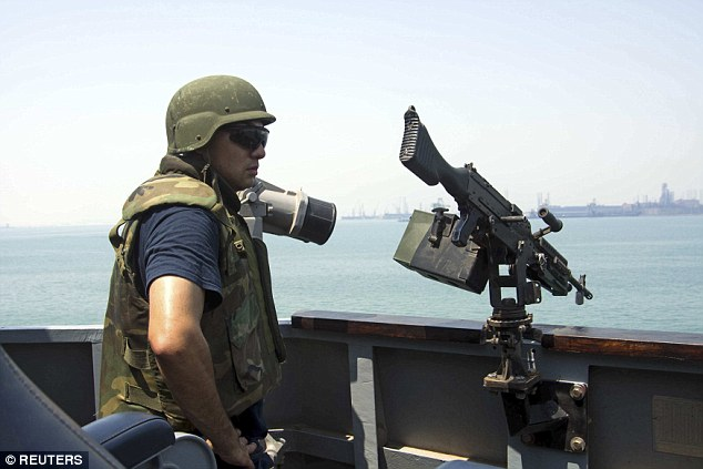 US Navy Fire Controlman 1st Class Jorge Correa scans for threats on the guided-missile destroyer USS Mason in Bahrain on September 1