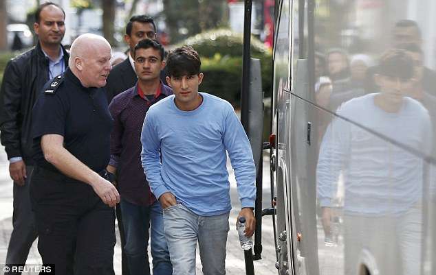 Two of the youngsters are escorted off the bus and taken to the Home Office office