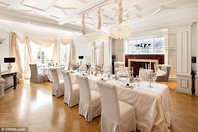 The huge dining room, pictured, is one of the features that appealed to the superstar