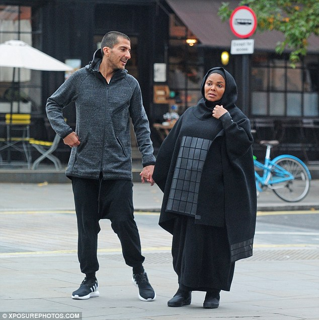 Having a laugh: Janet stole a serious moment when Wissam shared a joke with her