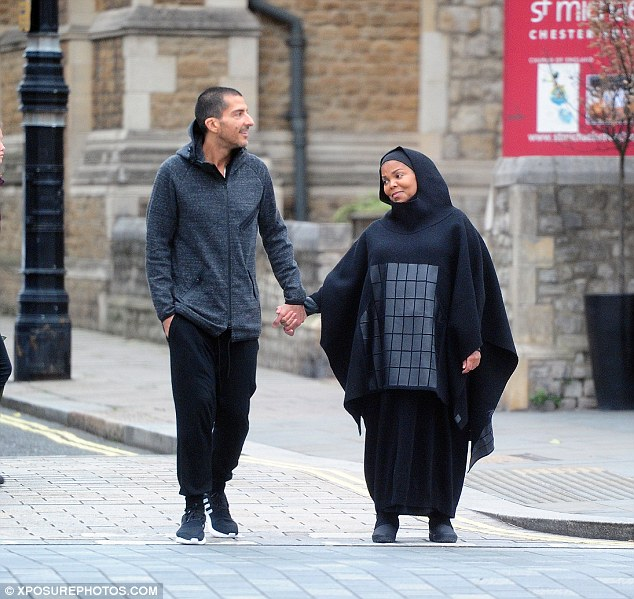 Hold me close: Janet looked at her husband adoringly during their walk