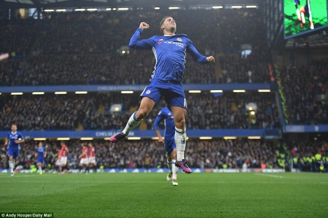 Hazard jumps for joy after putting Chelsea 3-0 ahead against Manchester United just after the hour mark