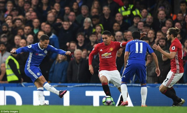 Eden Hazard shoots and scores to make it 3-0 and assure victory against Manchester United on Sunday