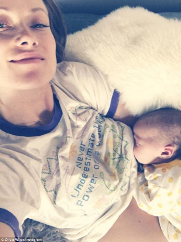'My drinking buddy': On Monday, Olivia Wilde posted an Instagram selfie in which she breastfed her 13-day-old daughter Daisy