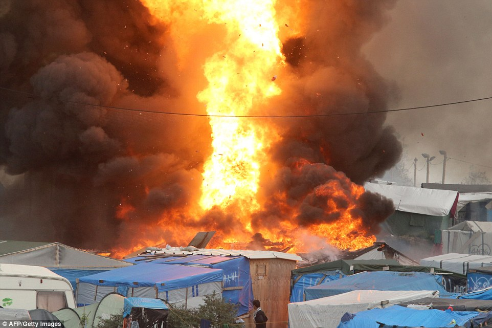 Eyewitnesses reported hearing a loud blast as flames ripped through tightly packed tents and huts