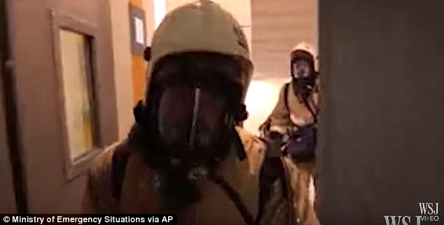 Video shows men in gas masks entering buildings as part of the chilling exercise drill