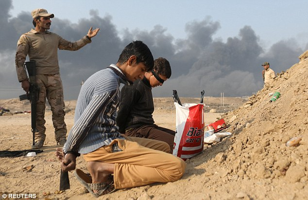 Iraqi security forces and Kurdish Peshmerga fighters are pushing towards Mosul along several axes and have been detaining ISIS fighters with 900 of them killed in the battle