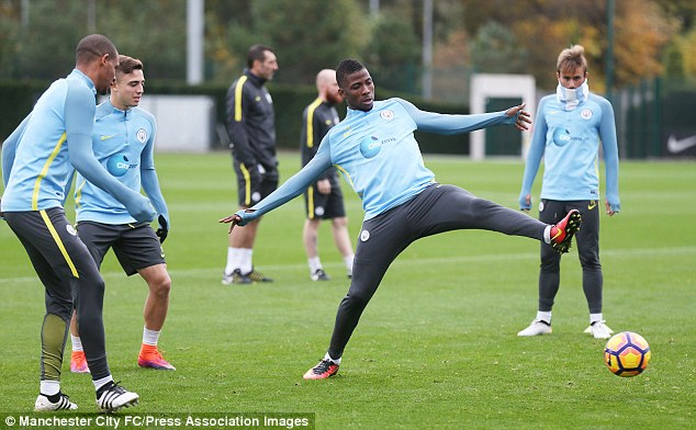 City striker Kelechi Iheanacho (centre) looks to get his foot on the ball during training