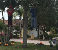 halloween picture black people hanging from tree trump sign