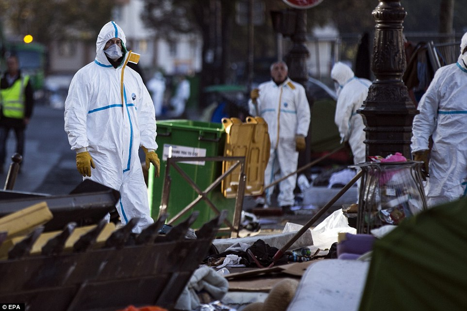 The clean up operation comes as the first ever official centre for refugees in Paris is due to be opened by the city's Socialist council later this week