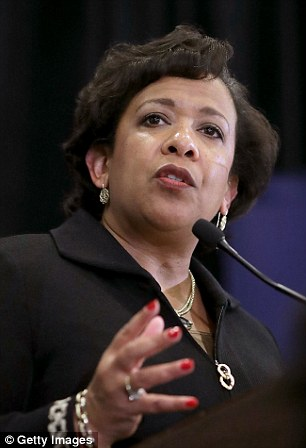 Head to head: Loretta Lynch was challenged by James Comey on whether he was being ordered not to tell Congress about the Clinton email development