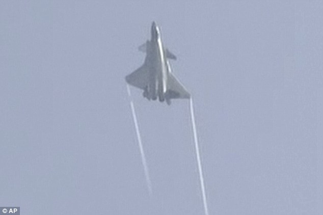 In this image made from video, the J-20 stealth fighter pulls a sharp incline to a a crowd of spectators and dignitaries at the Zhuhai airshow