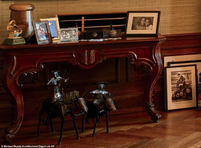 Framed family photos sit next to one of Obama's Grammy awards