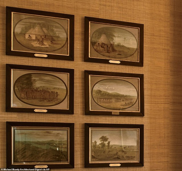 George Catlin scenes of Native American life hang on the walls over some of Obama's memorabilia. Catlin was borin Pennsylvania in 1796 and spent most of his life travelling and painting Native America scenes.