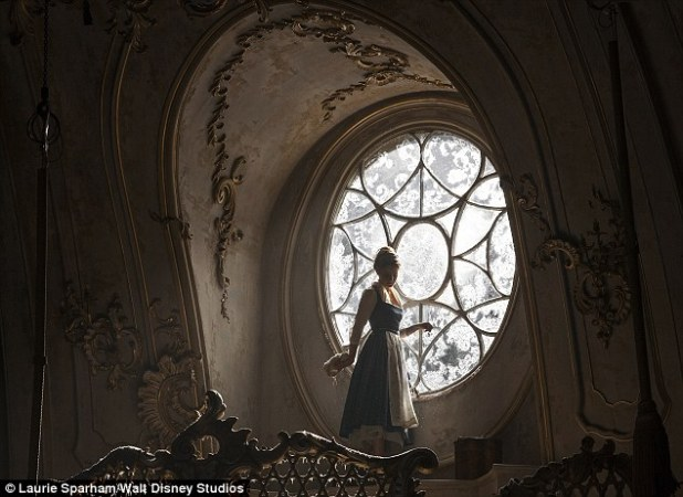 Convincing: Dressed in a beautiful flowing yellow ballgown, the 26-year-old British actress looks every inch a beautiful Belle in the stunning new snap