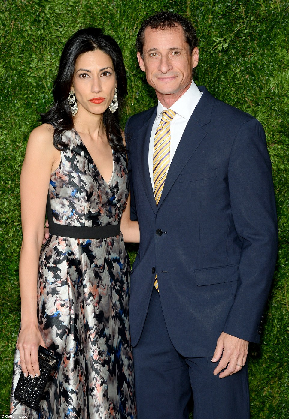 The investigation was reopened on October 28 - sparked by a DailyMail.com story that revealed Anthony Weiner (pictured with his wife, Huma Abedin - who is Hillary Clinton's top aide) was sending sexually explicit messages to a 15-year-old girl