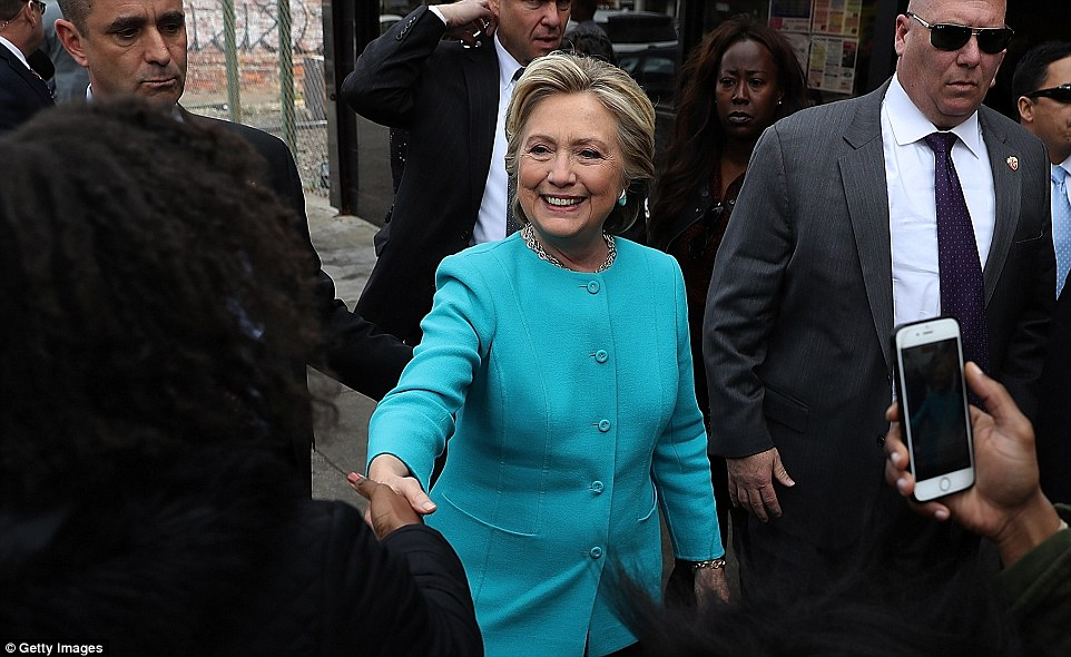 Hillary Clinton (pictured on Sunday morning) was all smiles after being again cleared by the FBI after the investigation into her emails was reopened
