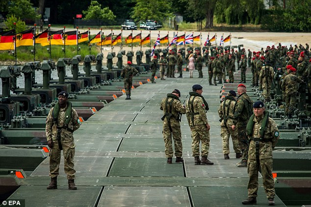 Nato soldiers stand on a pontoon bridge constructed across the Vistula river in Poland during the NATO Anaconda-16 exercise earlier this year