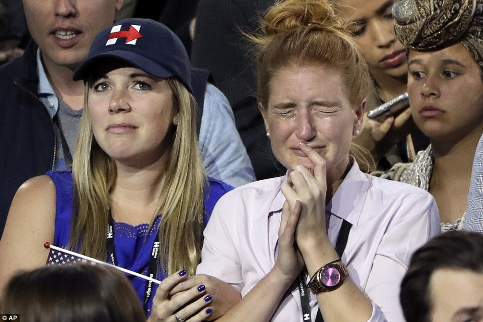 Heartbroken: Hillary Clinton supporters cry as theywatch the election results during Democratic presidential nominee Hillary Clinton's election night rally in the Jacob Javits Center's glass enclosed lobby