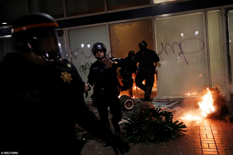 Oakland: Police try to control chaos at an office building that was attacked, graffitied and then set alight