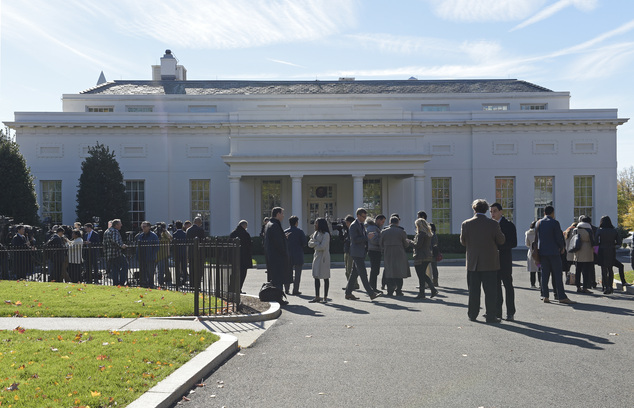 People gather outside the West Wing of the White House in Washington, Thursday, Nov. 10, 2016, as they wait for the arrival of President-elect Donald Trump t...