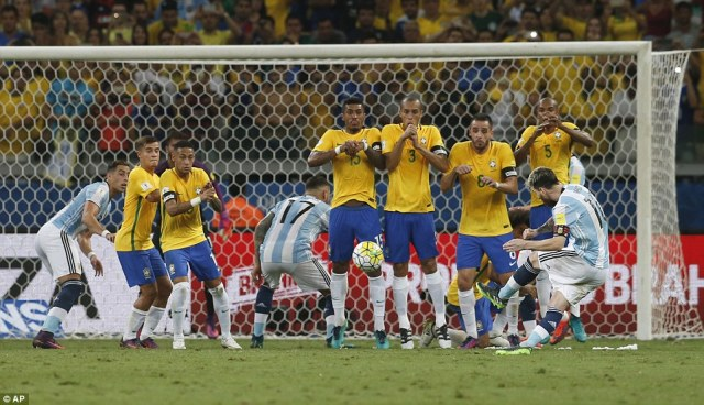 As Argentina look to respond, he can only fire his free-kick against the Brazialian wall as the first-half drew to a close