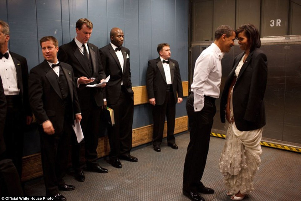 January 20, 2009. 'We were on a freight elevator headed to one of the Inaugural Balls. It was quite chilly, so the President removed his tuxedo jacket and put it over the shoulders of his wife. Then they had a semi-private moment as staff member and Secret Service agents tried not to look'