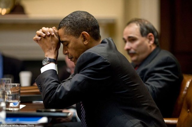 President Obama appears in deep thought as he and senior adviser David Axelrod listen during a climate change meeting in the Roosevelt Room of the White House. A moment later, he was 'laughing at a humorous exchange'.