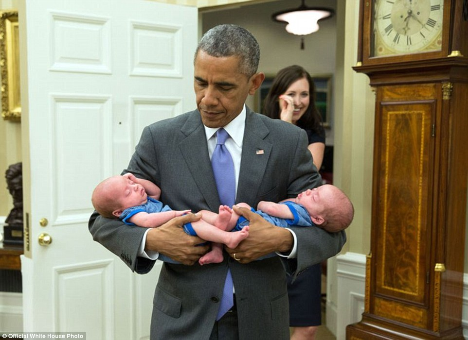 June 17, 2015. The President carries the twin boys of Katie Beirne Fallon, Director of Legislative Affairs, into the Oval Office just a few months after they were born